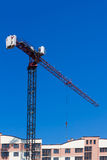 Crane and building construction on blue sky background Royalty Free Stock Photos