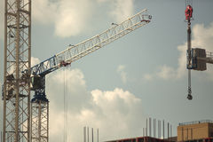 Crane and building construction Stock Images