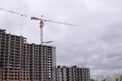 Crane and building construction. New city place for many tall buildings under construction Royalty Free Stock Image