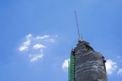 Crane and building construction site against blue sky Stock Photo