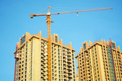 Crane and building construction site Royalty Free Stock Photo