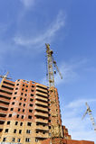 Crane and building construction site against blue sky Royalty Free Stock Photo