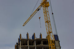 Crane and building construction site against blue sky Stock Images