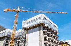 Crane and building construction site. Royalty Free Stock Image