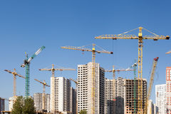 Crane and building construction site against blue sky. Stock Photography