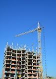 Crane and building construction site with copy space. Royalty Free Stock Image
