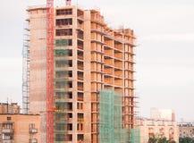 Crane and building house under blue sky Stock Photos