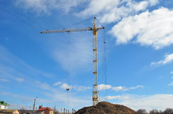 Crane Building New House on the Construction Site. House building good for economic growth. Stock Photos