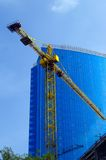 Crane and building office. Crane on the background of building office Royalty Free Stock Images