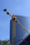 Crane and building office. Crane on the background of building office Stock Photo