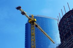 Crane and building office. Crane on the background of building office Stock Images