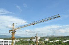 Crane and building working progress, construction site Royalty Free Stock Photo