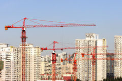 Crane and buildings. Residential buildings and crane at beijing Stock Image
