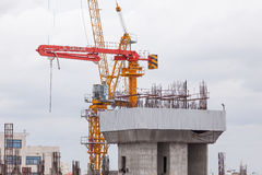 Crane and buildings are in construction site. Bangkok, Thailand - July 18, 2015: Crane and buildings are in construction site at Bangkok Stock Image