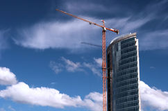 Crane builds business center Royalty Free Stock Photos
