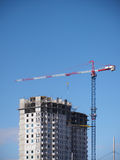 Crane builds house. Blue sky Royalty Free Stock Photos