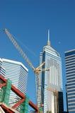 Crane and business buildings stock photos
