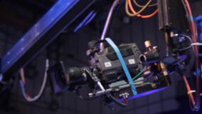 A crane with a camera on a suspension in a TV studio during a tv broadcast