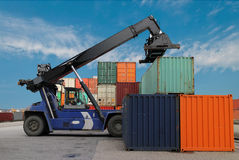 Crane and cargo container Stock Images