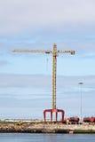 Crane at a Cargo Dock. Photo of a crane at a cargo dock stock images