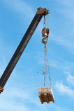 Crane and cargo. Stock Photo