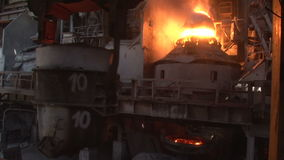Crane carries the bucket for metal stock video footage