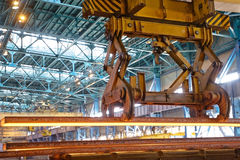 Crane carries metal at the plant Royalty Free Stock Photos