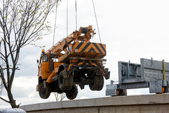 Crane carrying a cargo Royalty Free Stock Images