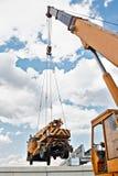 Crane carrying a cargo Stock Photo