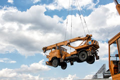 Crane carrying a cargo Royalty Free Stock Image