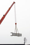 Crane carrying a cargo Royalty Free Stock Photography