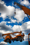 Crane carrying a cargo Stock Images