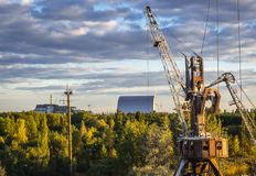 Crane in Chernobyl Zone. Abandoned port crane in Chernobyl Exclusion Zone, Ukraine. Chernobyl Nuclear Power Plant on background Royalty Free Stock Photo