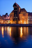 The Crane in City of Gdansk at Night. The Crane in Old Town of Gdansk at night in Poland, medieval landmark and symbol of the city with reflection on Old Motlawa Stock Images