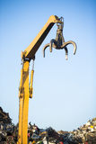 Crane claw on top of pile with scrap metal Stock Photography