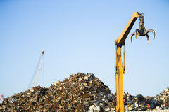 Crane claw on top of pile with scrap metal Stock Image
