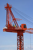 Crane in the clouds. Crane crew prepare for work. Taken from an adjacent building Royalty Free Stock Photography