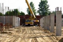 Crane between columns Royalty Free Stock Images