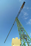 Crane and concrete pile Royalty Free Stock Image