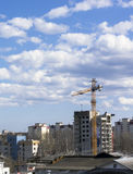 Crane is constructing high-rise building Stock Image