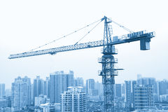 A crane in the constructing site, Guangzhou residential area in Royalty Free Stock Photos