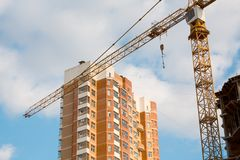 Crane and construction. Cranes and building on a background blue sky Stock Image