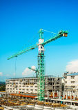 Crane at construction. Blue sky background stock photos