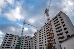Crane construction bricks concrete building in city Royalty Free Stock Image