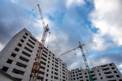 Crane construction bricks concrete building in city Royalty Free Stock Photos