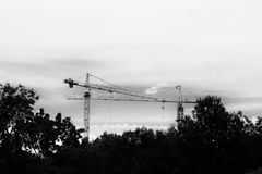 Crane in construction building site. black and white tone image.  royalty free stock images