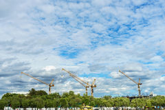 Crane construction in the city under the blue sky Stock Images