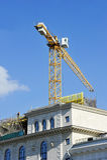 Crane construction completes attic Stock Photo
