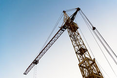 Crane. Construction cranes after workday. you can see the blue sky background Royalty Free Stock Photo