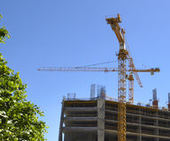Crane. On the construction of a house in the city of kiev Stock Photos